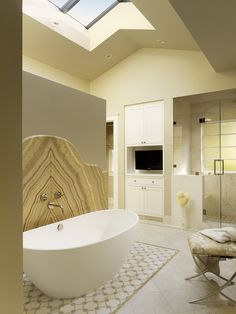 """free standing tub with book-matched marble """"back splash"""". DELICIOUS. By Melanie Coddington"""