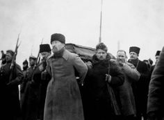 Pallbearers carrying Lenin's coffin during his funeral, from Paveletsky Rail Terminal to the Labour Temple. Felix Dzerzhinsky at the front with Timofei Sapronov behind him and Lev Kamenev on the left.