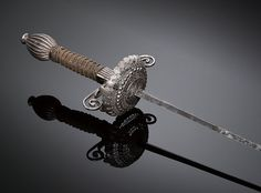 A late 17th century European rapier sword. SF Ballet's production is set in the Italian  Renaissance; true to the period, the men  fight with rapiers (straight, double-edged  swords with narrow blades), daggers,  bucklers (small, round shields), and capes.