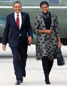 President Barack Obama and the First Lady Michelle Obama prepare to board Air Force One at Andrews Air Force Base, MD.
