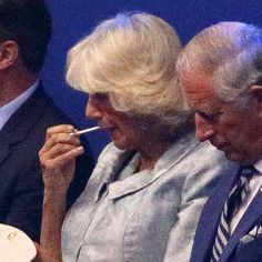 The Queen and the Duchess of Cornwall found time to put on a bit of lippy. | The 28 Most Important Pictures From The Commonwealth Games Opening Ceremony