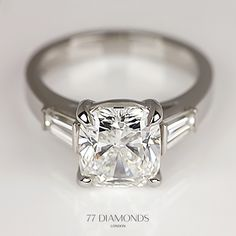 This bespoke creation features 3 carat cushion flanked by 2 tapered baguettes. #engagementring