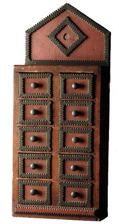 Pine 10 drawer hanging cupboard with applied chip carved decoration. Late 19th c.