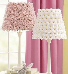 Glue silk flowers on lamp shades for a spring or feminine look to decorate a room.