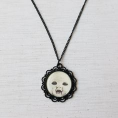 Creepy Doll Face Necklace Gothic Weird Macabre by TheGrungeMonkey
