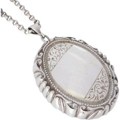 This exquisite, one-of-a-kind, heavy sterling silver locket features a wonderful grooved scroll decoration along the sides. Vintage c1930