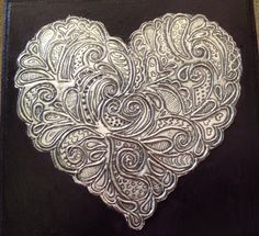 Embossed heart on a jewelry box by Heather van den Bergh