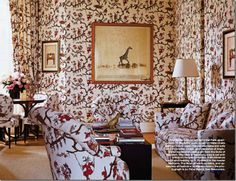 Lee Radziwill's Paris library also featured in Elle Decor is upholstered in a Louis XV documentary Chinoiserie fabric by Le Manach. The art deco giraffe has traveled with her.