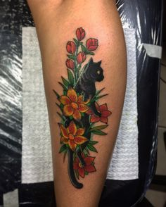 Black cat and flowers tattoo