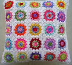 colors in white granny square cushion cover by riavandermeulen, via Flickr