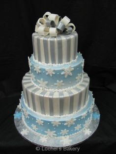 Winter Wedding snowflake cake. Fondant sliver and light blue