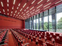 Dietrich I Untertrifaller, Bruno Klomfar · Strasbourg Convention Centre Marie Curie, Strasbourg, Contemporary Architecture, Architecture Details, Auditorium Architecture, Column Covers, Steel Columns, Innovation Centre, Red Interiors