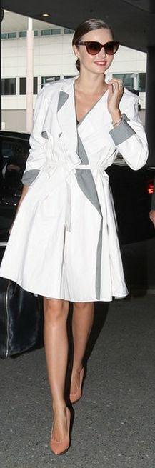 Who made Miranda Kerr's nude pumps, brown cat eye sunglasses, and black handbag? Shoes – Lanvin  Sunglasses – Prada  Purse – Celine  Charm – Louis Vuitton