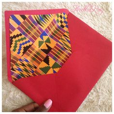 Here is the finished product. ArethaRay wedding invitations. African inspired with Kente cloth design. $.70 per envelope or $13.00 for 50