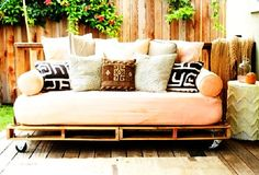cool-cozy-and-modern-DIY-pallet-outdoor-daybed I like this idea for a patio or deck