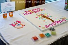 a {day} with lil mama stuart: Colorful Owl 1st Birthday Party: Decorations   LOVE the guest art!