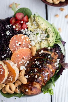 Black Rice Salad Bowls with Chipotle Orange Chicken, Cashews + Feta by halfbakedharvest #salad_bowl #rice #black_rice #forbidden_rice #oranges #chicken #breasts #cashews #feta #avocado #tomatoes #cilantro #green_onions #adobo #healthy