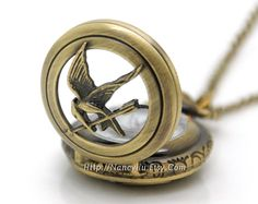 The Hunger Games Pocket Watch Necklace, Inspired Mockingjay Locket Necklace With Arrow in Antique Bronze. $3.95, via Etsy.