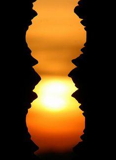 Sunset through Angkor Wat's columns.
