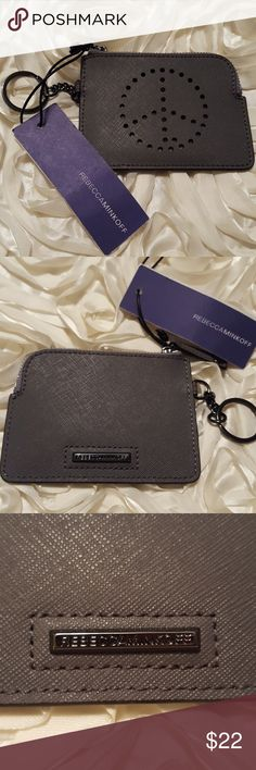 Rebecca Minkoff peace sign coin purse & keychain NWT Rebecca Minkoff leather peace sign coin purse and keychain. Style name is 'Peace Little Lottie'. Very cute!! The peace sign design is perforated in the purse. Can fit change and credit cards; measures 4.5 inches long, and 3 inches high. I ship same day or next day,and I accept all reasonable offers! Rebecca Minkoff Accessories