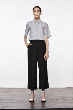 "It's Time To Start Building That ""Real Adult"" Wardrobe #refinery29  http://www.refinery29.com/2016/07/116936/updownacross-new-clothing-brand#slide-2  Your new work uniform looks something like this.Updownacross Pinstripe Button Down Crop Top, $124, available at Updownacross...."