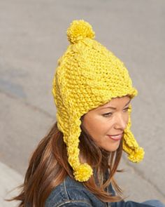 Brighten up your cold weather look with this fun, chunky-knit earflap hat. Shown in Bernat Softee Chunky.