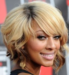 Keri Hilson's short style without all the tight curls; I like them both!