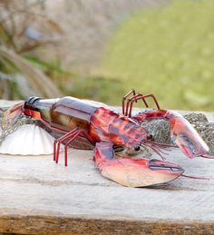 Recycled Bottle Lobster.. From Windandweather.com. I wonder if I could figure out how to make this?