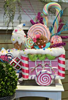 Candyland The kids will love the bright colors and whimsical details of a candy land-themed holiday display.  Pinks, blues, greens and purples create a bri