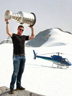 King for a day - Willie Mitchell/L.A. Kings atop Mount Benedict, B.C. with Stanley Cup.  Jeff Vinnick/NHLI - Getty Images