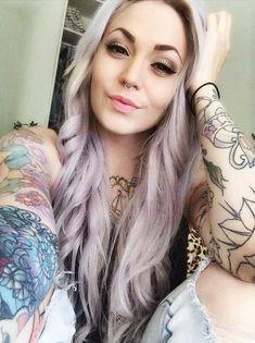 Cute smile, tattooed girl, septum piercing
