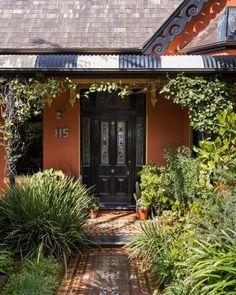 The house entry is framed by a Madagascar jasmine (Stephanotis floribunda) growing along the verandah. How great are the tessellated tiles?!