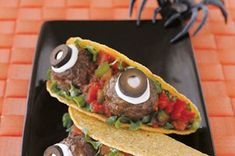 Spooky Eyeball Tacos - I layer ground taco meat on the bottom of the shell to make them more edible, but they are a super cute and idea...one of the few things on my halloween table people will eat.