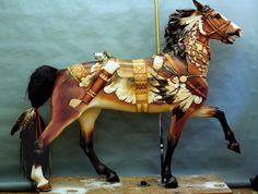 Carousel horse: Indian paint pony with intricate saddle blanket, beads, feathers, and quiver. (Hawkeye Studio)