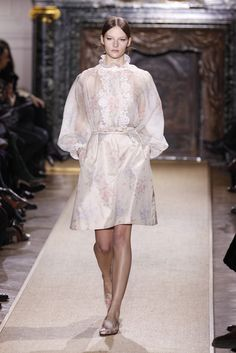 Valentino Spring 2012 Couture    Oh, for the simple life! But how to reconcile its embrace with the extravagance of couture?    Maria Grazia Chiuri and Pierpaolo Piccioli did so by infusing their couture en plein air with a soupcon of Marie Antoinette at the Petit Trianon. The result was a Valentino collection with a surface so lovely and gentle that it masked the lineup's core bravado.    The designers opened with gowns in whisper-soft prints, including a shamrocks-for-luck version. These…