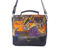https://www.cityblis.com/6016/item/16673  NAVY LEATHER AND PRINT SATCHEL, at 30.00% off by Mefie  The Mefie blue satchel combines our eye-catching patchwork design with leather, perfect for your everyday essentials.  The vibrant print along with deep hues will provide a punchy accent for a high impact look.         Also available in Deep Orange and Tan    Front Flap - Digital Print on Cotton wit...