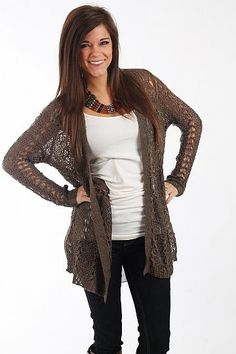 "Close To Home Cardigan, Mocha $54.00  What a great open knit cardigan! This soft, slightly stretchy cardigan is a great color to go with lots of your outfits, and you can wear this piece all year long! Just layer it under coats and jackets this winter then wear it alone over tanks in the warmer months!   Fits true to size. Miranda is wearing a S/M.   From shoulder to hem:  S/M - 31""  M/L - 32.5"""