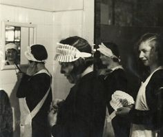 legrandcirque: Hotel maids getting ready for work in a bathroom,