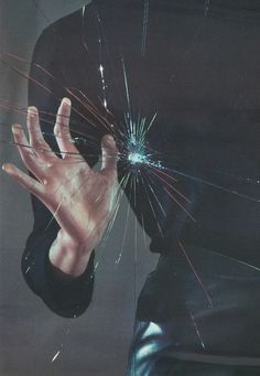 i pushed my hand forward against the glass. harder. harder. it began to crack under my hand.