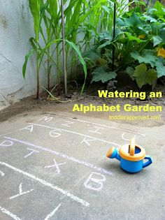 Watering an alphabet garden - looks so fun for toddlers!