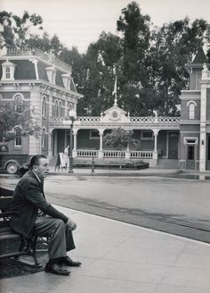 Walt, relaxing on a bench of Disneyland Town Square.