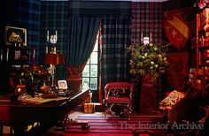 This study is decorated in contemporary Scottish Baronial style complete with a display of shields, tartan upholstery and wall coverings