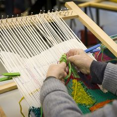 Mireille Guerin -- working on a tapestry on a frame loom, with cartoon clipped on the back. Notice the multiple-warp-wrapping.