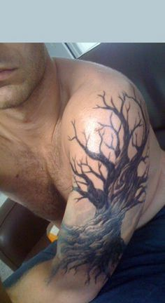 Mysterious dead tree tattoo. A majestic looking dead tree with a flair of mystery in it s always a great subject for an interesting piece of tattoo.