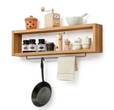 Oak Wood Shelf with a hanging rail for kitchen necessities. The Wandregal Eichenholz (Oak Wood Shelf) is 90 centimeters wide; €240 from Manufactum.  To create a similar look, use a wall-mountable Billy Shelf; 50.00 from Ikea.  On the underside of the Billy shelf, attach a Baren Towel Rail; 12.99 from Ikea.  Great idea for the kitchen