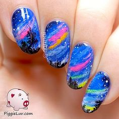 Colorful glow in the dark Northern Lights nail art
