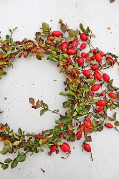 A beautiful wreath with rose hips that symbolizes Mary, the mother of Jesus as the rose.