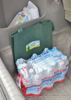 Finding a solution for trash is an important part of car organization...and I found the perfect super-cheap answer: Command hooks. They're ideal for holding a plastic grocery bag for easy trash disposal.