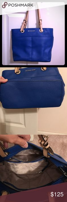 Michael Kors Bedford Tote This bag is absolutely beautiful! It has 4 exterior pockets as well as 5 interior pockets. It's all leather and in perfect condition! Dustbag included Michael Kors Bags Totes