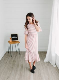Meet your must-have dress for this season!  The waistline and fit is ultra flattering on all body types.  It beautifully features a ruffle hem, ruffle cuffs, half sleeves, and a rounded neck.
